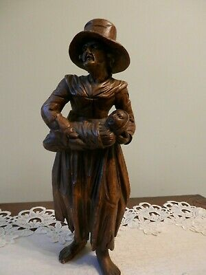Old German Black Forest Hand Carved Figure Of A Women In A Hat With A Baby.
