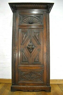 Antique heavily carved wardrobe / hall coat cupboard
