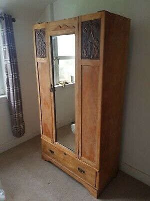Antique oak wardrobe with carved detail
