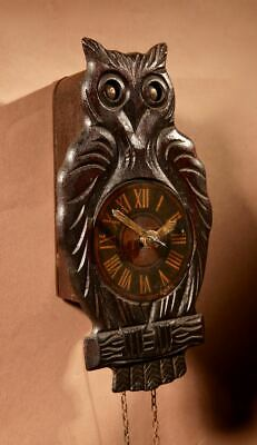 A Black Forest Original Moving Eyes Black Forest Owl wall clock, circa 1900-20