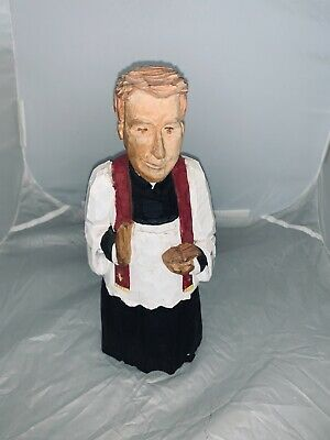 polished wooden carved priest (religious)