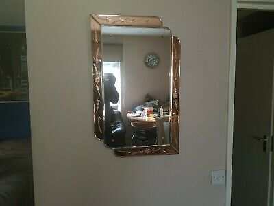 Art Deco 1930s Peach frameless bevelled mirror. In good condition, used.