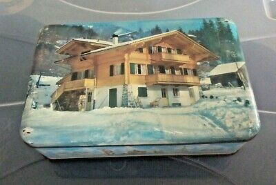 Vintage Nestles tin with ski chalet and snow scenes