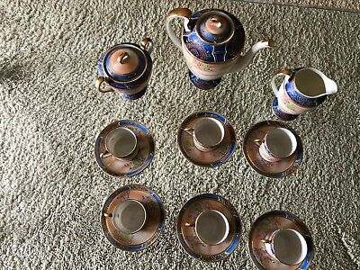 Antique porcelain 9 piece coffee service. delicate translucent and beautiful