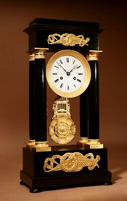 A Finely Made French Louis Philippe Ebonised and Ormolu Portico Mantel Clock Cir
