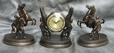 A Nice Precista Bronzed Spelter Winged Isis Clock With Marley Horse Garniture