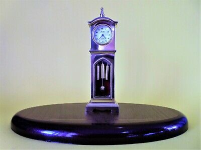 A stunning quartz Grandfather clock made in solid brass