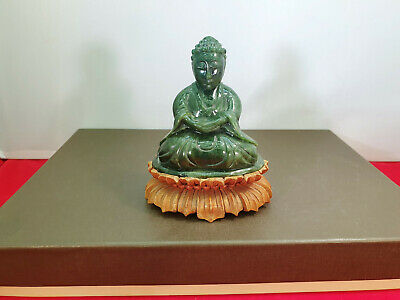 Carved spinach green nephrite ( jade ) stone Buddha sculpture on wooden stand