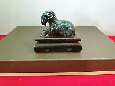 Carved black jadeite ( jade ) stone Ram sculpture on wooden stand, rare color