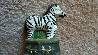 Zebra Cast Iron Door Stop on Raised Base with Gold Colored Leaf Pattern