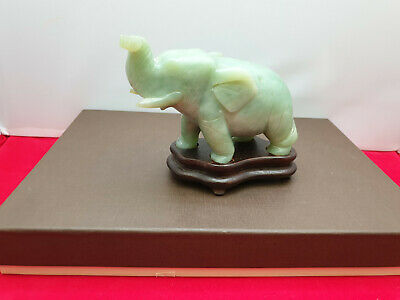 Carved translucent grey green jade stone Elephant sculpture on wooden stand