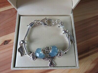 New Kim Rogers Quality Charm Bracelet Angel Wings Silver Tone Blue Faceted Stone