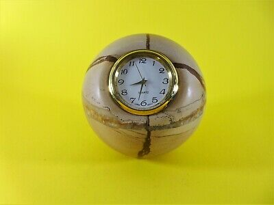 A very unusual solid marble/onyx paperweight with a quality quartz clock fitted