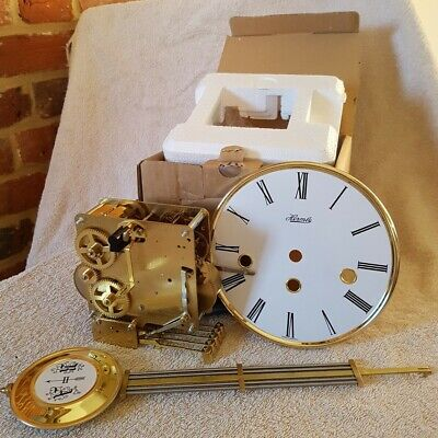 NEW HERMLE FHS 341-020A CLOCK MOVEMENT with 45cm Pendulum and white dial.