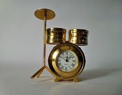 A Vintage Drum Set in Solid Brass with a working quartz movement clock