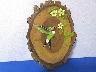 Vintage Hummingbird Painted with Yellow Flowers on a Wood Slice in Michigan