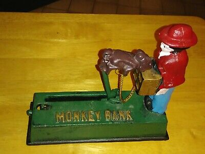 """Collector's Cast Iron Mechanical """"Monkey Grinder"""" Penny Bank by Monogram Box"""