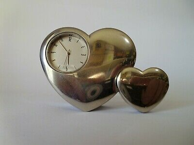 A very unusual double heart paperweight with a quality quartz clock fitted
