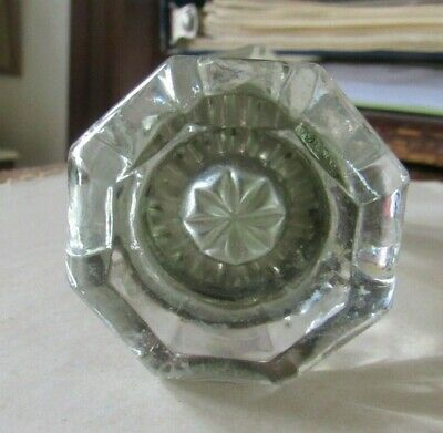 Matched pair of glass doorknobs with star center - 8 points & metal spindle