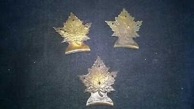3 x SMALL ANTIQUE BRASS  PICTURE HANGING BRACKETS. IN THE SHAPE OF A MAPLE LEAF.