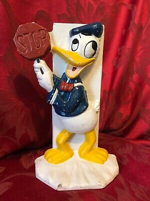 Vintage Cast Iron Door Stop Bookend Donald Duck with Stop Sign /A