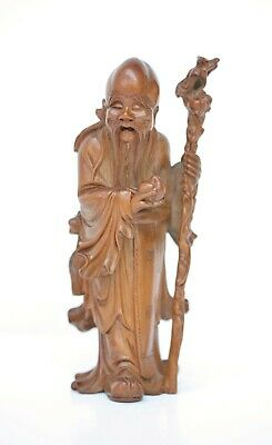 Fine antique Chinese boxwood figure of Shou Lao holding the Peach of Immortality
