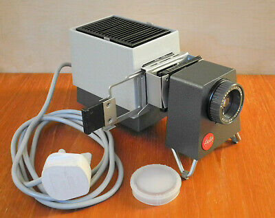 Leitz Pradix Slide Projector for 35mm slides small and very portable with papers