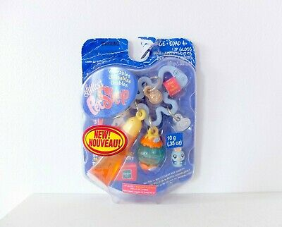 Littlest Pet Shop Wearables Bird with bird cage charm and orange lipgloss