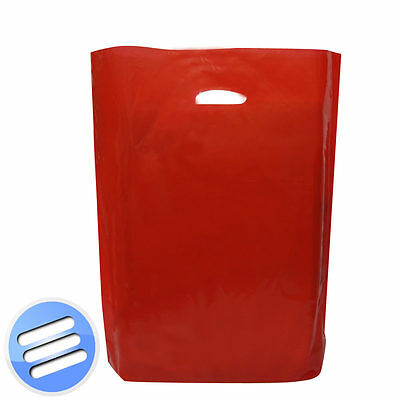 """100 x RED PUNCH HANDLE PLASTIC CARRIER BAG FOR SHOP/ BOUTIQUE/ GIFT: 15"""" x 18"""""""