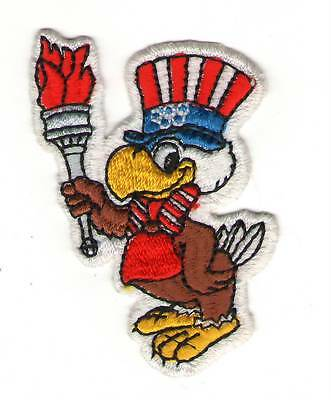US Olympics Torch Flame USA Eagle Animated Uncle Sam Patch skate biker shirt cap
