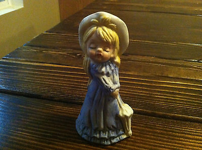 VINTAGE GIRL IN A BLUE DRESS WHITE HAT WITH UMBRELLA PARASOL FIGURINE BELL