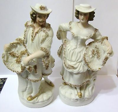 Pair of Late 19th/early 20th century Bisque Continental Figures with gold gilt
