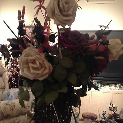 Old Open Work Vse Made Of Twigs With  Huge Mount Of Designer Roses And Foliage
