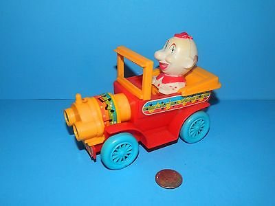 Vintage toy JIMSON CLOWN in ANTIQUE CAR wind up works and jerks