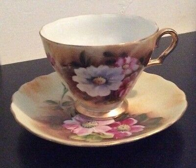 Enesco Hand Painted (?) Teacup and Saucer