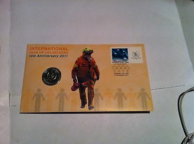 2011  $1.00  Unc coin on First Day Cover, INTERNATIOAL VOLUNTEERS
