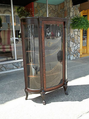 American Oak China Closet with Claw Feet & Serpentine Glass front 20th century