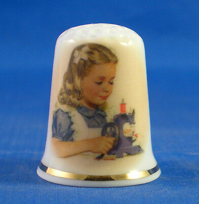 FINE CHINA THIMBLE - GIRL WITH TOY SEWING MACHINE