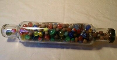 Vintage glass rolling pin full of various vintage marbles~wow!