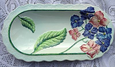 CARLTON WARE EMBOSSED BLUE HYDRANGEA SERVING DISH ON PAL GREEN BACKGROUND C 1952