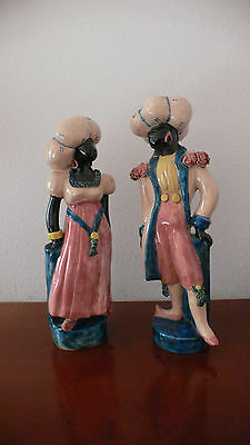 A Pair Of Antique Italian Porcelain Polychrome Decorated Blackamoore Figures