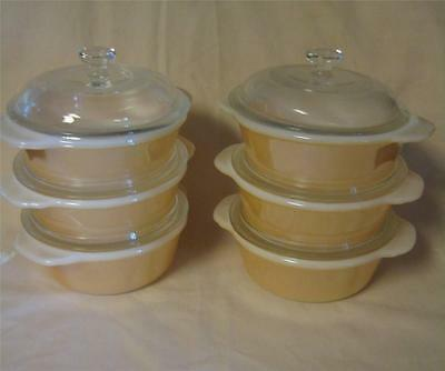 LOT OF 6 FIRE KING INDIVIDUAL CASSEROLE DISHES WITH LIDS.PEACH LUSTER.MINT COND.