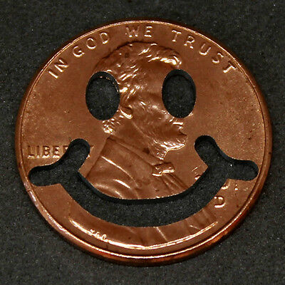 Lucky penny with smiley face cut out