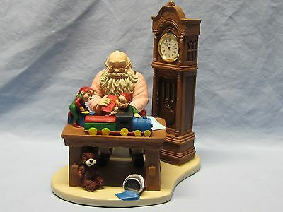 """Howard Miller """"Making Toys for Good Girls and Boys"""" Figurine w/H-M Clock Behind"""