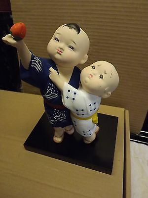 "Authentic Hakata Doll ""Siblings picking fruit "" Porcelain Figurine"