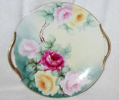 T & V LIMOGES HANDLED CAKE PLATE WITH PINK/YELLOW ROSES--ARTIST SIGNED STILES