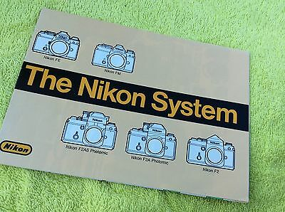 1980 Nikon F2 F2A F2AS FM FE Camera System Advertising Brochure - poster