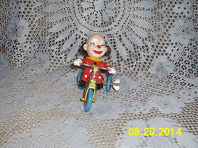 VINTAGE 1950,S WIND-UP TIN LITHO TOY - CLOWN ON TRICYCLE, MADE IN KOREA