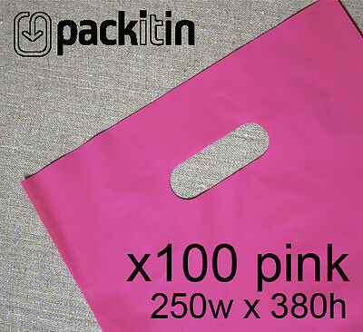 100 HOT PINK PLASTIC CARRY BAGS with die cut handle medium size - 250 x 380mm
