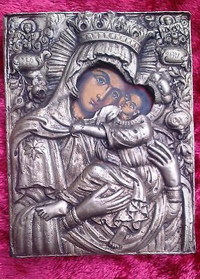 Old Orthodox 19th century silver, hand-painted icon of the Virgin Mary.